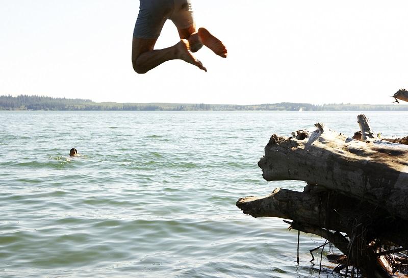 Man jumping fear risk summer fun vacation for blog